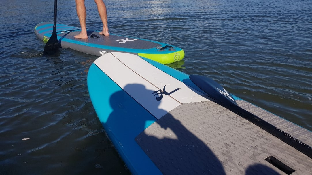 2 Stand up paddleboards on the water