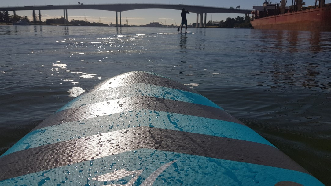 Stand up paddleboard with the Gateway Bridge in the background