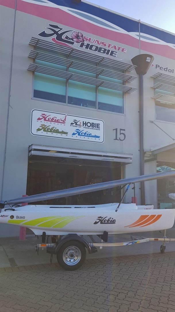 Hobie Bravo on trailer in front of Sunstate Hobie