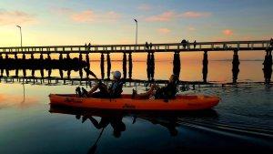 Kayak And Pier Silhouette