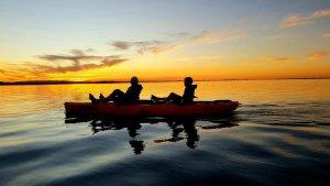 Silhouette Compassduo Kayak In Sunset