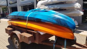 2 Double Kayaks Stacked On A Trailer